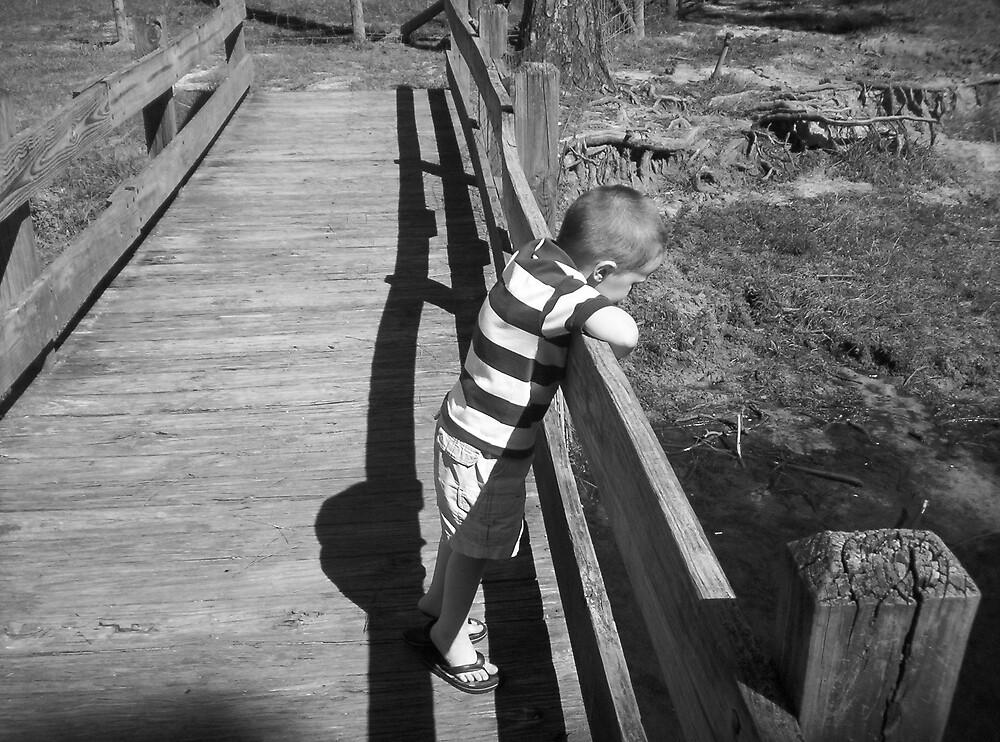Little boy on a bridge by lisasuttles