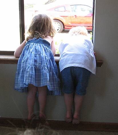 the other side of the kids in the window by MissTazzitude