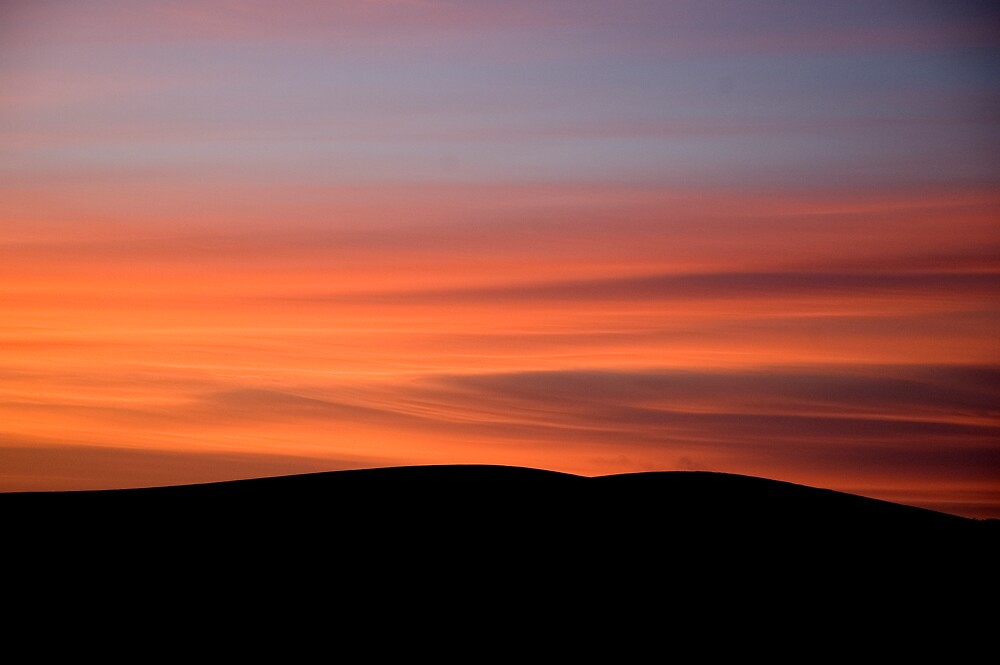 Sunset over Dublin Mountains by Ramona Farrelly