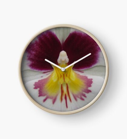 Butterfly in orchid Clock