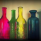 Vier leere Flaschen von Evita