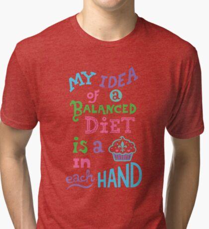 My idea of a balanced diet is a cupcake in each hand- light Tri-blend T-Shirt