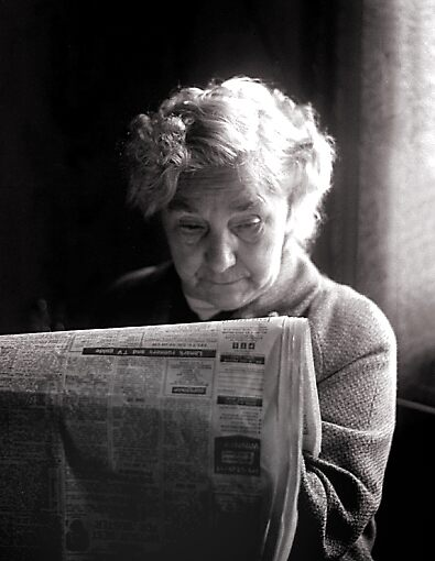 Lady with paper by david malcolmson