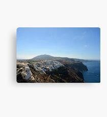Travel vacation destination. The perfect view of the Caldera in Oia, Santorini in Greece, with blue waters of the sea. Canvas Print
