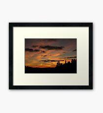 Illuminated Silhouettes Framed Print