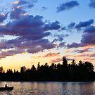 Canoeing at sunset by Elena Elisseeva