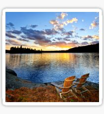 Wooden chairs at sunset on beach Sticker