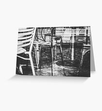 outdoor chairs in the city in black and white Greeting Card