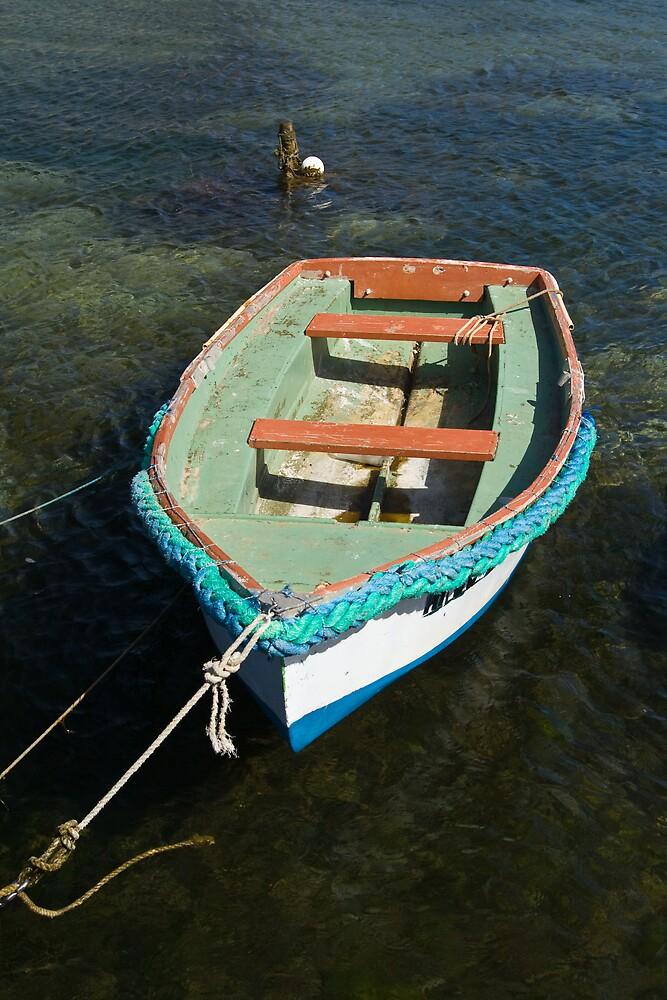 Small boat on water by dpearce
