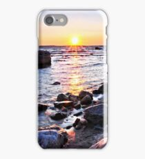 Sunset over water at rocky lake shore iPhone Case/Skin