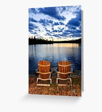 Wooden chairs at sunset on lake shore Greeting Card