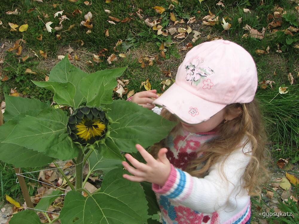 Hannah and her sunflower by gypsykatz