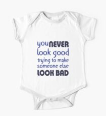Quote: You never look good trying to make someone else look bad One Piece - Short Sleeve