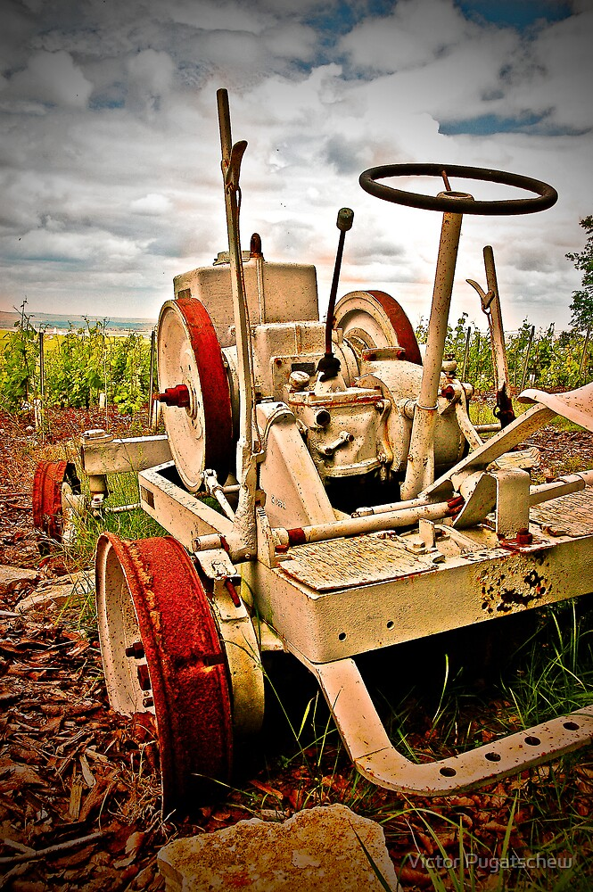 Old tractor at sunset - Cramant - Champagne region by Victor Pugatschew