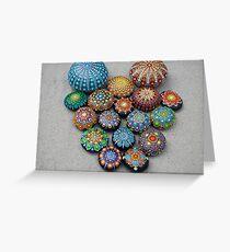 Mandala painted stones on sand. Greeting Card