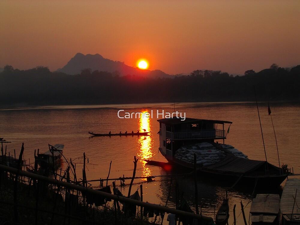 Sunset in Luang Prabang by Carmel Harty