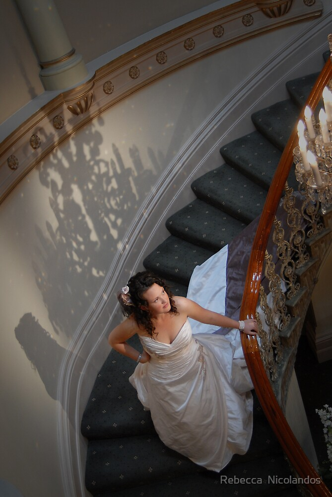 Bride on stairs by Rebecca  Nicolandos