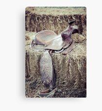 Vintage saddle on a hay bale Canvas Print