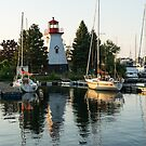 Picture Perfect - Little Lighthouse Framed by Yachts by Georgia Mizuleva