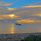 Sunrise over Shipwreck by shaken