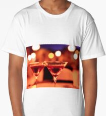 Martini glass on a table Long T-Shirt