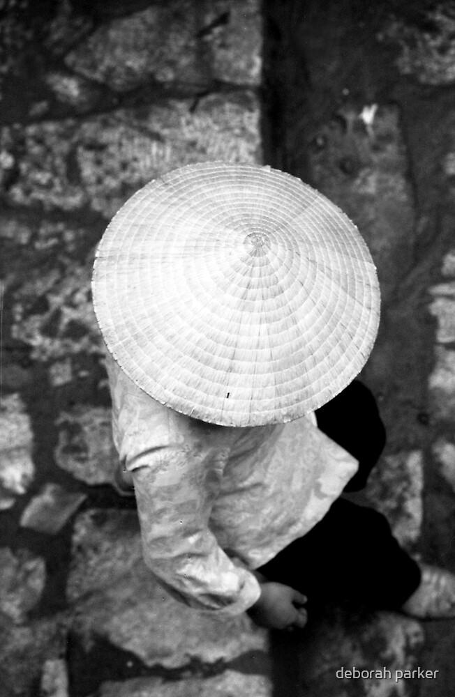 a hat above.... by deborah parker