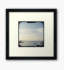 Boat on the ocean Framed Print