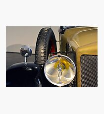 Detail of headlamp from vintage yellow car Photographic Print