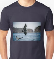 Pelican at the water edge  Unisex T-Shirt