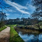 Vapour trails over the canal. by Colin Metcalf