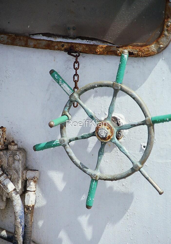 Steeringwheel on fishing boat by RoelfKlap