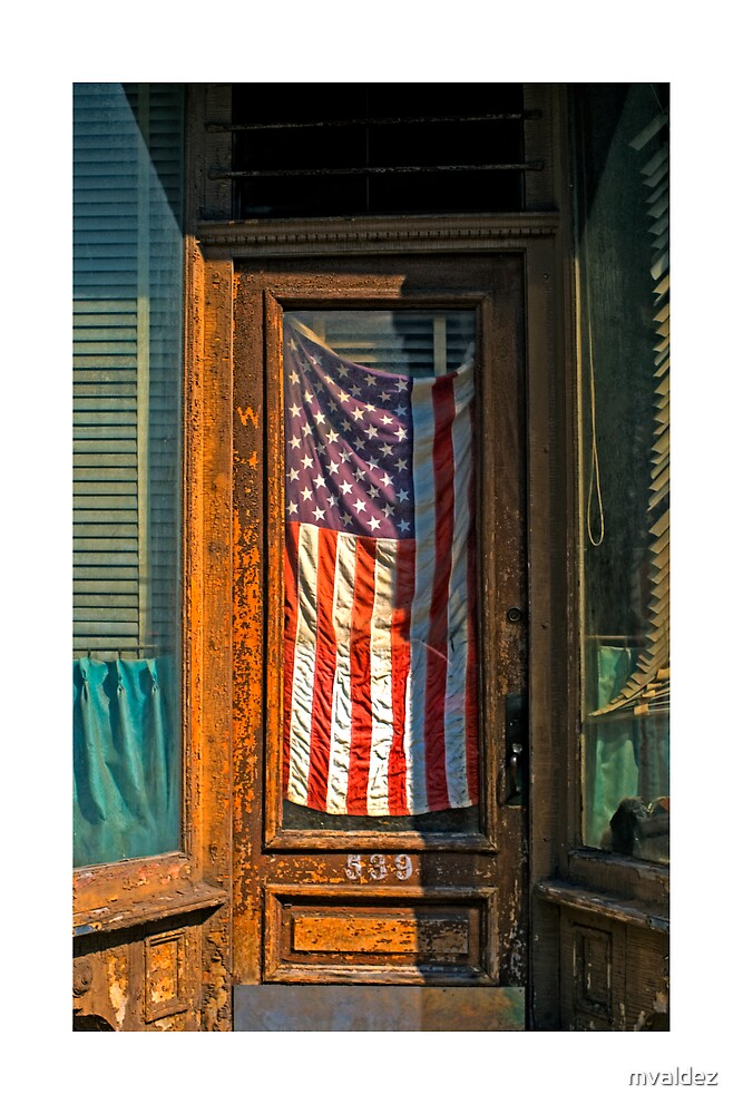 Flag in storefront window by mvaldez