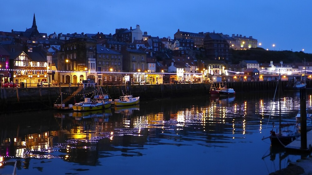 Whitby harbour lights and  town at night by Anna Myerscough