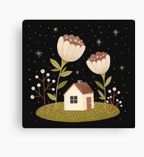 Tiny house among flowers Canvas Print