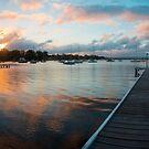 Sunset over the water by Karen Stevenson