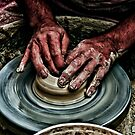 Hands of a potter  by PhotoStock-Isra
