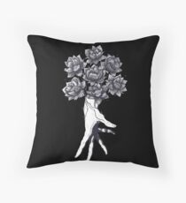 Hand with lotuses on black Throw Pillow