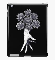 Hand with lotuses on black iPad-Hülle & Klebefolie
