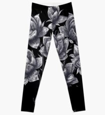 Hand with lotuses on black Leggings