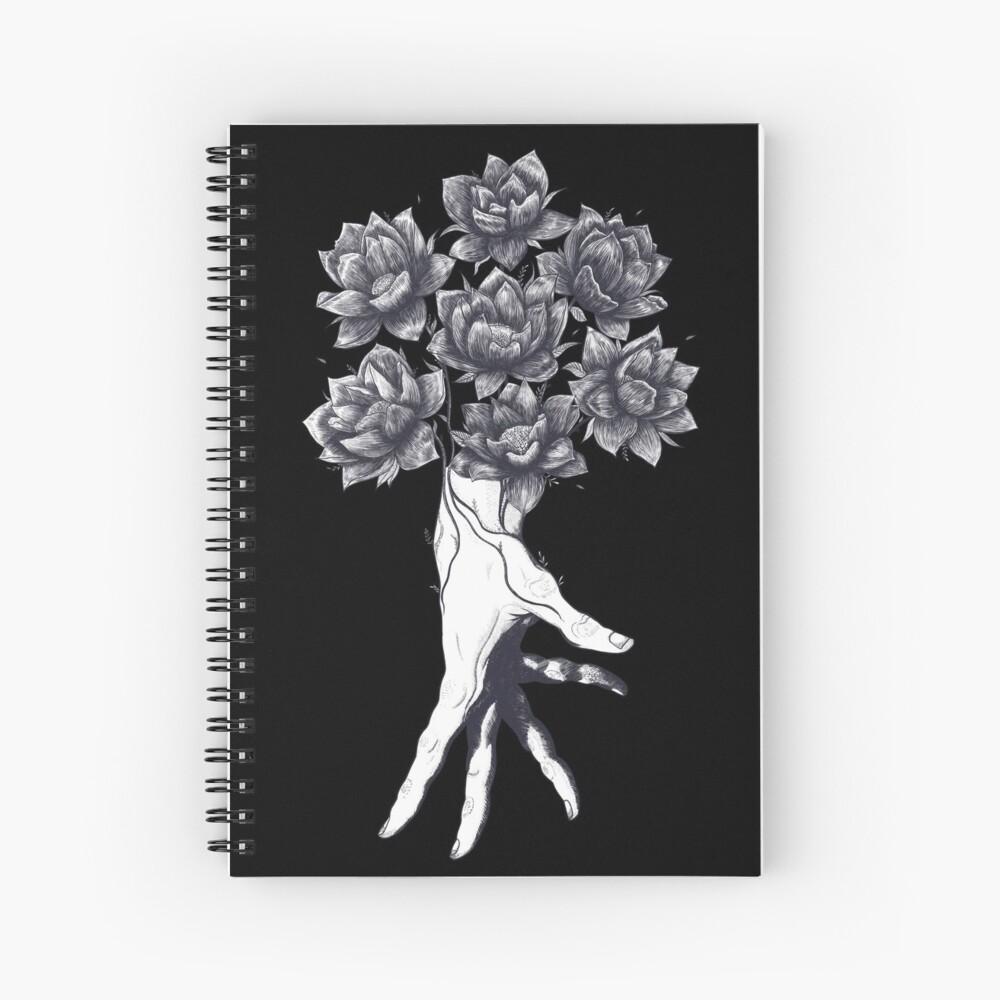 Hand with lotuses on black Spiralblock