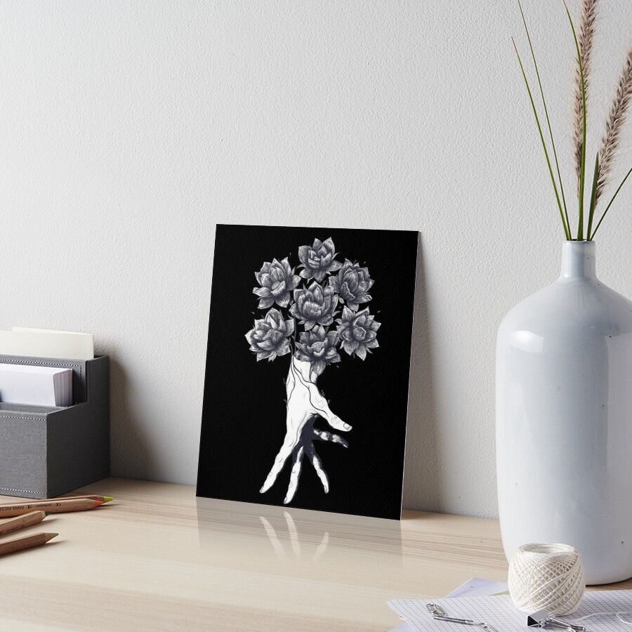Hand with lotuses on black Art Board Print