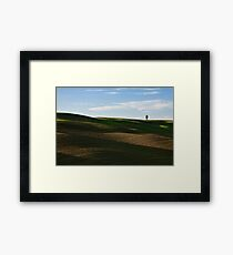 Lone tree over hills Framed Print