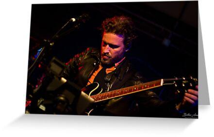 Rob Tuning his Guitar by Trishasaur