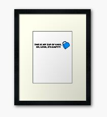 This is my cup of care. Oh look, it's empty! Framed Print
