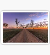 Country dirt road at sunrise Sticker