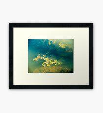 Freshwater river weeds in sunlight under the rippled aqua marine coloured water surface Framed Print