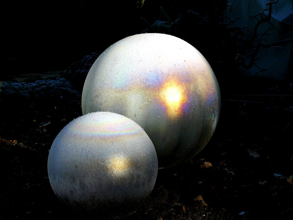 Glass globes covered with frost a pin point of sunshine bursts intothecolours of a rainbow by johnny2sheds