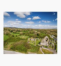 Aerial view of a beautiful old ruins of an Irish church and burial graveyard in county clare, Ireland. Set in the burren national park countryside landscape. Photographic Print