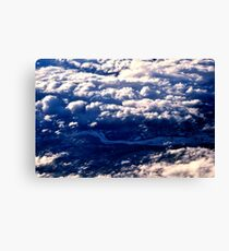 Above the clouds. The view from the plane Canvas Print