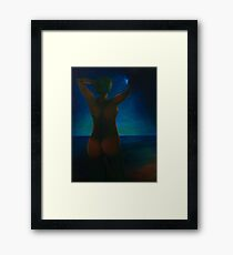Girl at night on the beach Framed Print